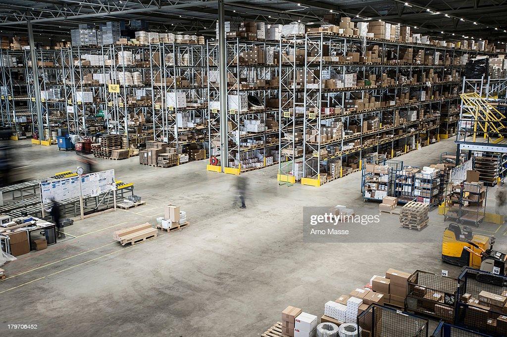 Vast distribution warehouse interior, elevated view