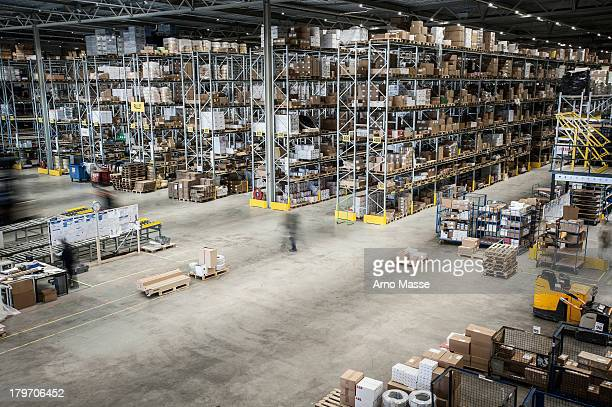 Vast distribution warehouse interior, elevated view