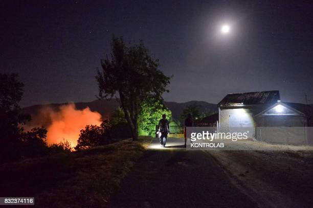 SILA LONGOBUCCO CALABRIA ITALY A vast fire in the Sila mountains in Calabria southern Italy near a home