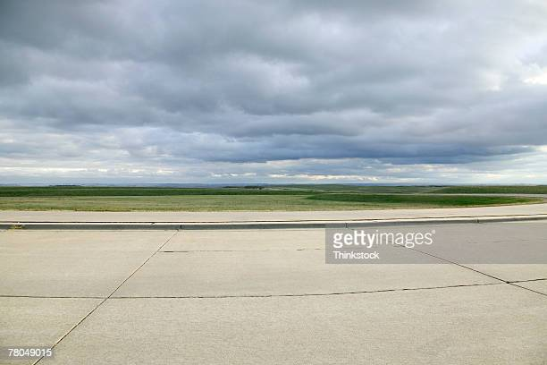 Vast landscape with airport tarmac