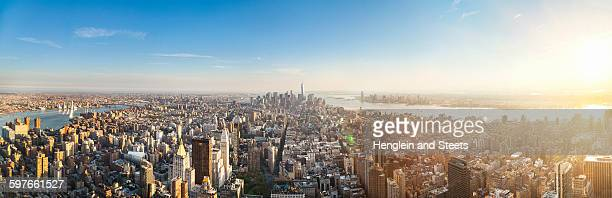Vast panoramic cityscape with skyscrapers and distant rivers, New York, USA