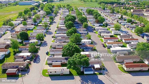 Vast trailer park, mobile home court on sunny summer morning.