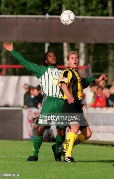 Vastra Frolunda's Anildo Spencer and BK Hacken's Jonas Henriksson wait for the ball to drop