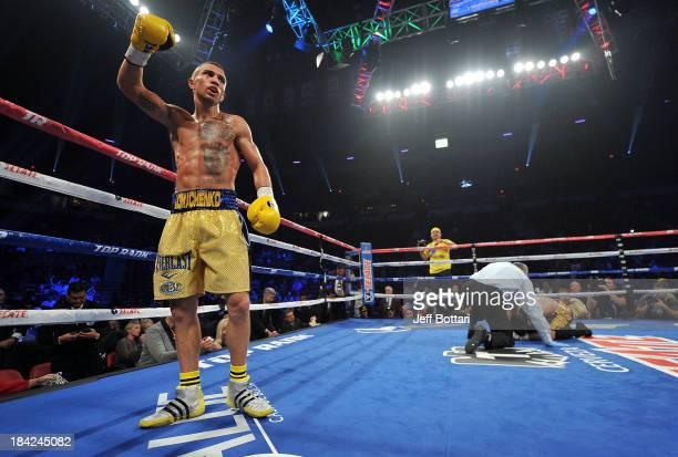 Vasyl Lomachenko celebrates after defeating Jose Ramirez during their featherweight bout at the Thomas Mack Center on October 12 2013 in Las Vegas...