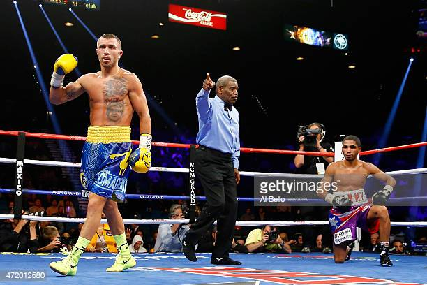 Vasyl Lomachenko celebrates after knocking out Gamalier Rodriguez in the 9th round during their WBO featherweight championship bout on May 2 2015 at...