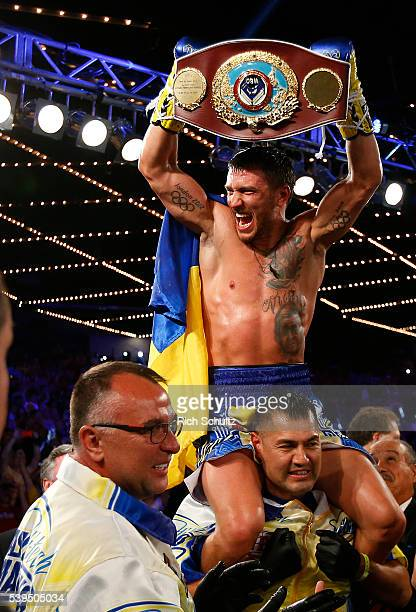 Vasyl Lomachenko holds the championship belt after defeating Roman Martinez by knock out during the fifth round of their Junior Lightweight WBO World...