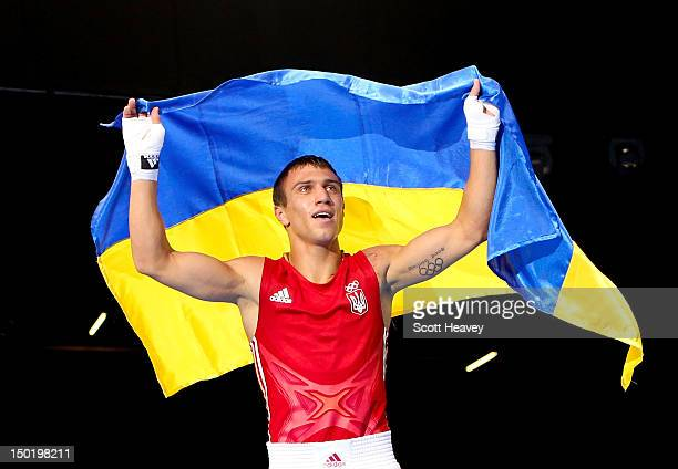 Vasyl Lomachenko of Ukraine celebrates defeating Soonchul Han of Korea during the Men's Light Boxing final bout on Day 16 of the London 2012 Olympic...