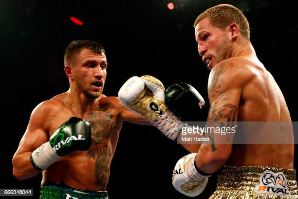 Vasyl Lomachenko of Ukraine exchanges punches with Jason Sosa during their WBO Super Featherweight World Championship bout at The Theater at MGM...