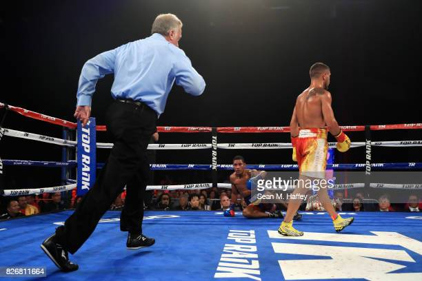 Vasyl Lomachenko of Ukraine knocks down Miguel Marriaga of Columbia at during the third round of their WBO World Championship Junior Lightweight...