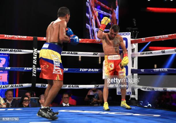 Vasyl Lomachenko of Ukraine taunts Miguel Marriaga of Columbia at during their WBO World Championship Junior Lightweight title fight at the Microsoft...