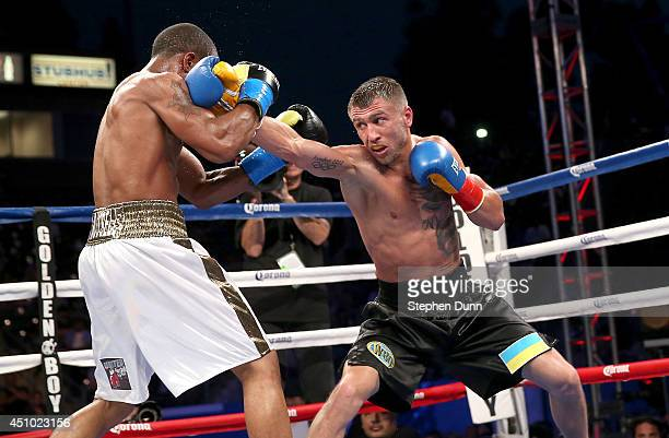 Vasyl Lomachenko throws a punch at Gary Russell Jr in their WBO Featherwieight Title bout at StubHub Center on June 21 2014 in Los Angeles California...