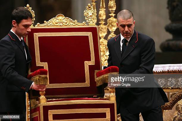Vatican attendants move the throne of Pope during a mass celebrated by Pope Francis at St Peter's Basilica in the occasion of the 18th World Day for...