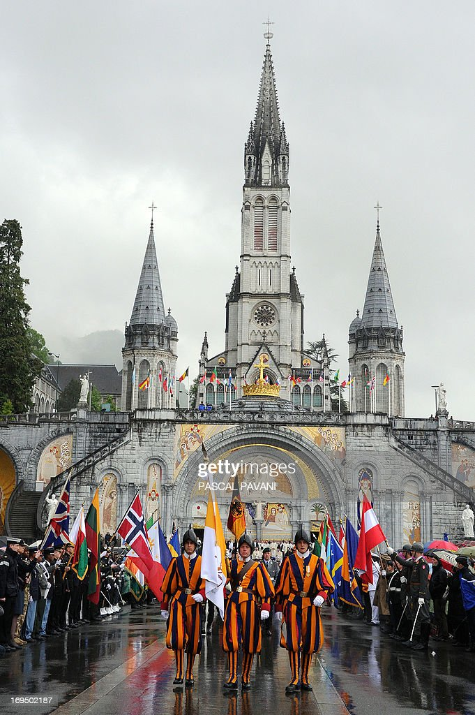 Vatican City Swiss guards parade in front the Basilica of our Lady of the Rosary in the French southwestern pilgrimage city of Lourdes on the day of the opening parade of the 55th International Military Pilgrimage, on May 25, 2013. The city of Lourdes welcomed over 12,000 soldiers and their families from 35 countries during the pilgrimage, which runs from May 24 to 26.