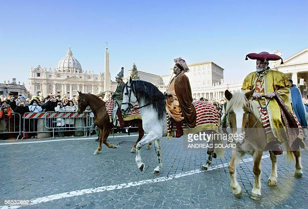 Extras disguised as the 'Three Kings' from the Italian Valnerina province arrive on horseback 06 January 2006 in StPeter's square to assist the...
