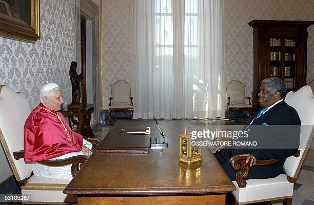 Pope Benedict XVI talks with Zambian President Levy Patrick Mwanawasa during their meeting at the Vatican 20 June 2005 AFP PHOTO/ POOL / OSSERVATORE...