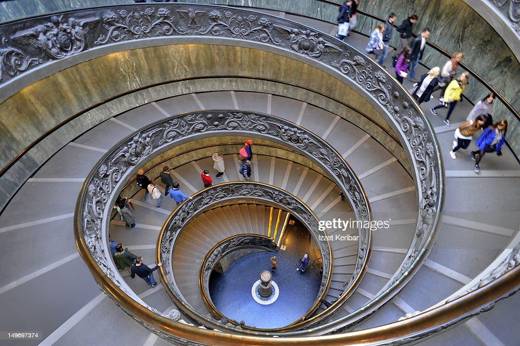 Vatican Museum spiraling stairs.