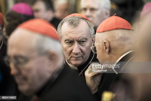Vatican Secretary of State cardinal Pietro Parolin chats with a cardinal during the Christmas greetings at the Clementina Hall on December 22 2016 in...