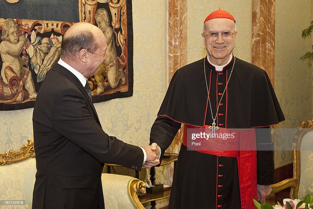 Vatican Secretary of State cardinal Tarcisio Bertone attends a meeting with President of Romania Traian Basescu on February 15 2013 in Vatican City...