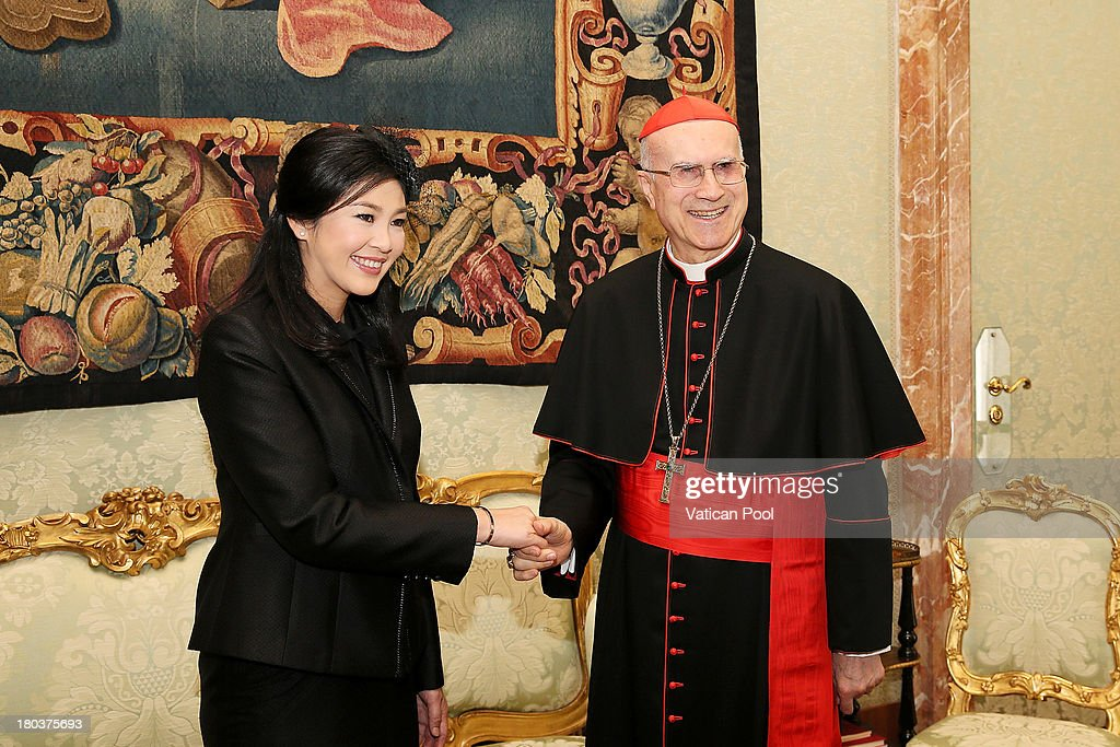 Vatican Secretary of State Cardinal Tarcisio Bertone meets Thailand's Prime Minister Yingluck Shinawatra after an audience with Pope Francis at the...