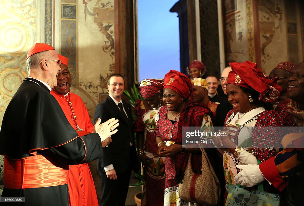 Vatican secretary of State cardinal <a gi-track='captionPersonalityLinkClicked' href=/galleries/search?phrase=Tarcisio+Bertone&family=editorial&specificpeople=549351 ng-click='$event.stopPropagation()'>Tarcisio Bertone</a> (L) poses with newly appointed cardinal John Olorunfemi Onaiyekan (2ndR), archbishop of Abuja Nigeria, and his diocesans during the courtesy visits at the Sala Regia Hall at the end of the concistory held by Pope Benedict XVI on November 24, 2012 in Vatican City, Vatican. The Pontiff installed 6 new cardinals during the ceremony, who will be responsible for choosing his successor.