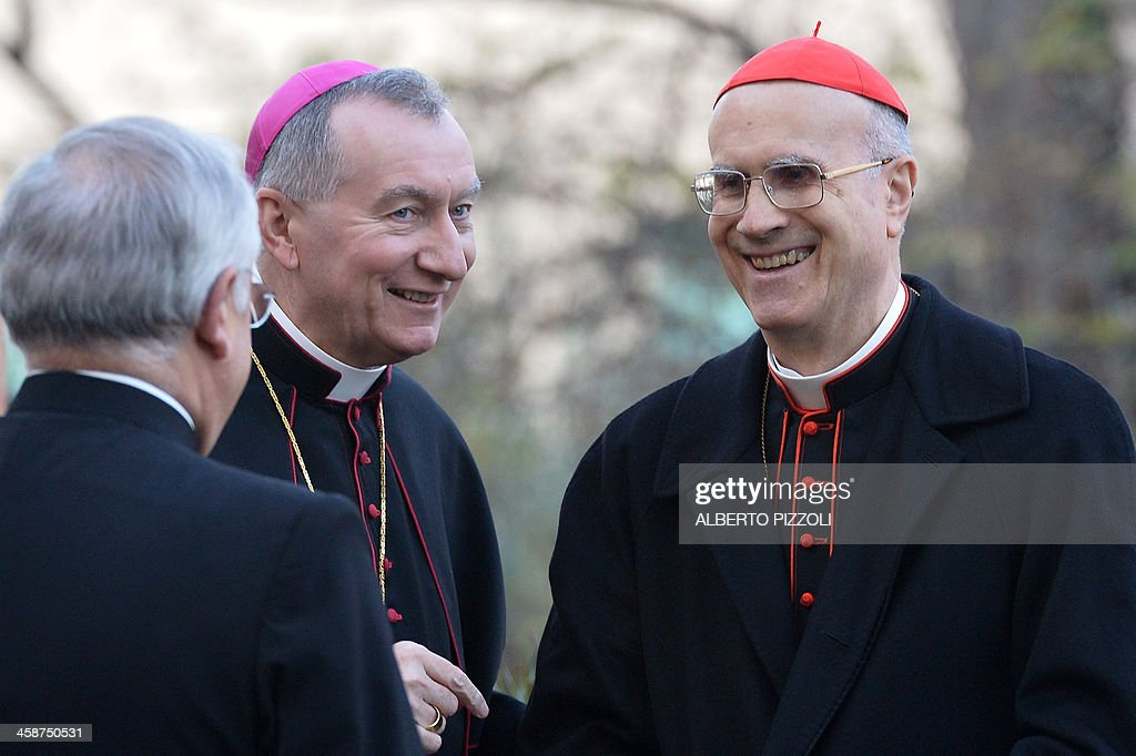 Vatican Secretary of State Pietro Parolin speaks with former Vatican Secretary of State cardinal Tarcisio Bertone before the arrival of Pope Francis...