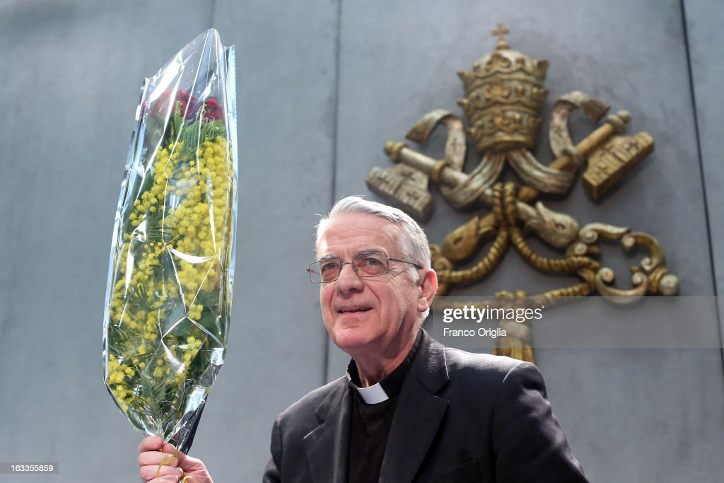 Vatican spokesman father Federico Lombardi holds a bunch of mimosa, a flower marking the International Women's Day on March 8, as he arrives at the Holy See press room for a briefing on the seventh general congregation of cardinals on March 8, 2013 in Vatican City, Vatican. Father Federico Lombardi said that during this session cardinals accepted Scottish cardinal Keith O'Briens's reasons for not attending the Vatican Conclave to elect a new Pope.