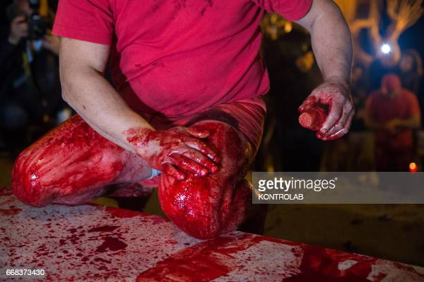 A Vattiente affects himself during the ritual of Vattienti that takes place on the night between Holy Thursday and Holy Friday during Holy Week in...