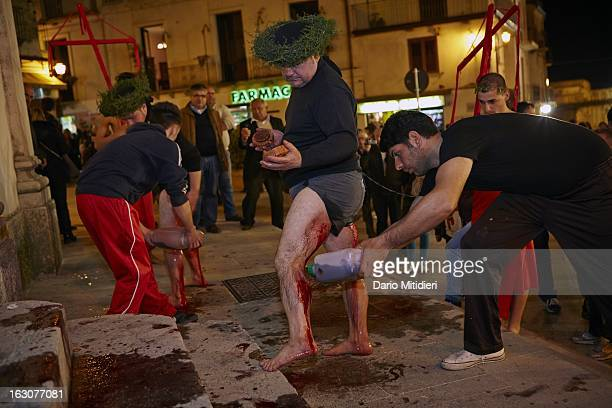 A Vattiente has his blood covered legs cleaned with wine in front of the main church Nocera Terinese Italy April 7 2012 The Rite of the Vattienti...