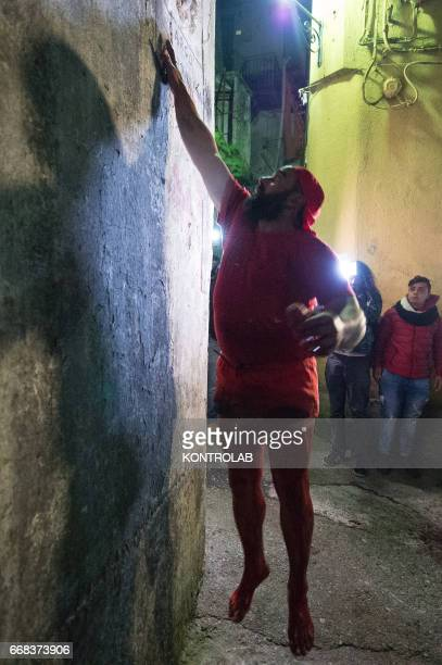 A Vattiente leaves its imprint of blood on the wall during the ritual of Vattienti that takes place on the night between Holy Thursday and Holy...