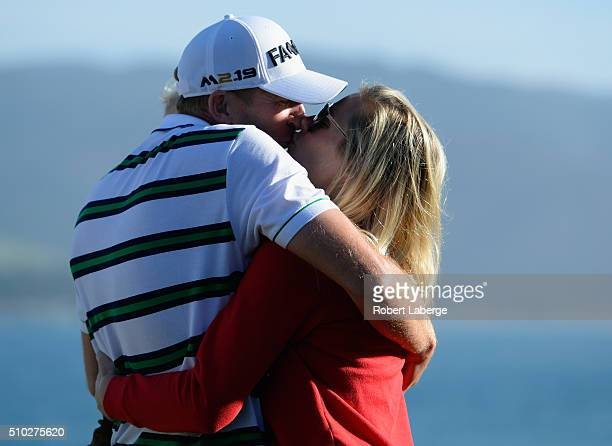 Vaughn Taylor celebrates with wife Leot and son Locklyn after winning the ATT Pebble Beach National ProAm at the Pebble Beach Golf Links on February...