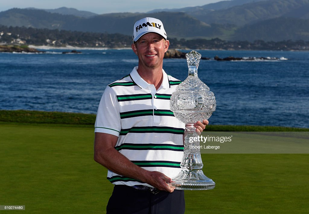 Vaughn Taylor poses with the trophy after winning the AT&T Pebble Beach National Pro-Am at the Pebble Beach Golf Links on February 14, 2016 in Pebble Beach, California.