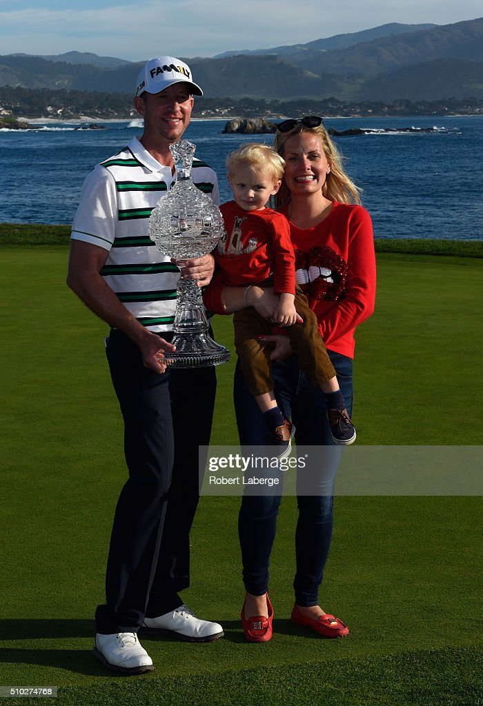 Vaughn Taylor poses with the trophy along with wife Leot and son Locklyn after winning the ATT Pebble Beach National ProAm at the Pebble Beach Golf...