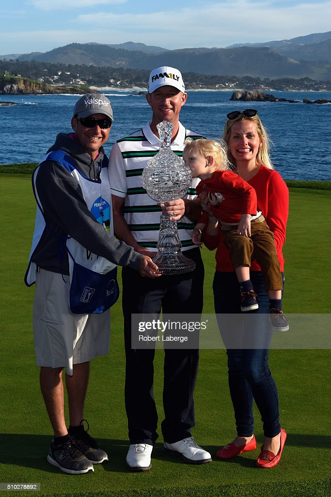 Vaughn Taylor poses with the trophy, along with wife Leot, son Locklyn, and caddie Dan Padawer after winning the AT&T Pebble Beach National Pro-Am at the Pebble Beach Golf Links on February 14, 2016 in Pebble Beach, California.