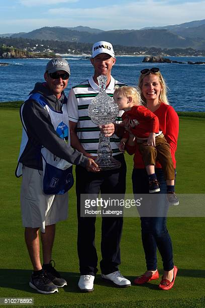 Vaughn Taylor poses with the trophy along with wife Leot son Locklyn and caddie Dan Padawer after winning the ATT Pebble Beach National ProAm at the...