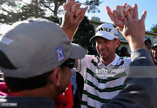 Vaughn Taylor reacts after winning the ATT Pebble Beach National ProAm at the Pebble Beach Golf Links on February 14 2016 in Pebble Beach California
