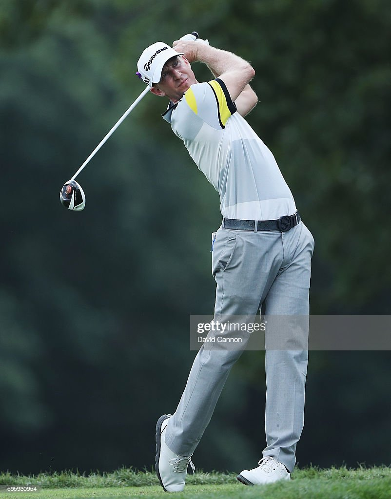 Vaughn Taylor watches his tee shot on the fifth hole during the second round of The Barclays in the PGA Tour FedExCup PlayOffs on the Black Course at...