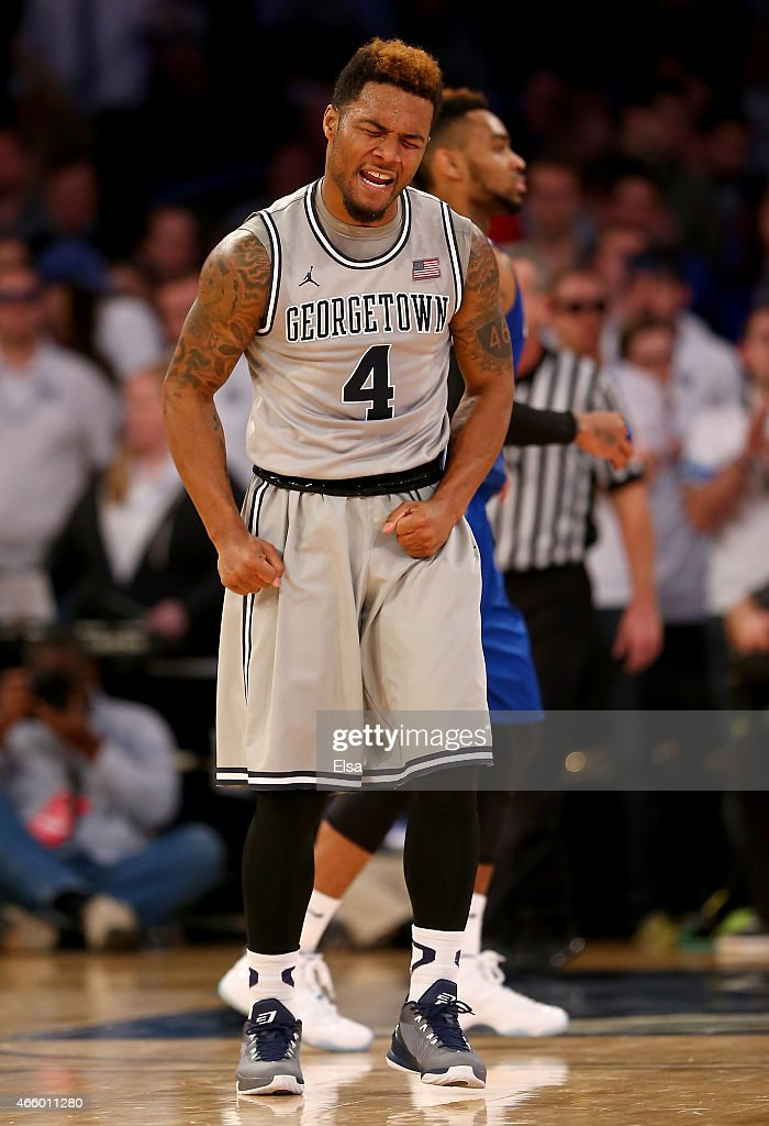 Vauntes SmithRivera of the Georgetown Hoyas celebrates late in the second half against the Creighton Bluejays during a quarterfinal game of the Big...