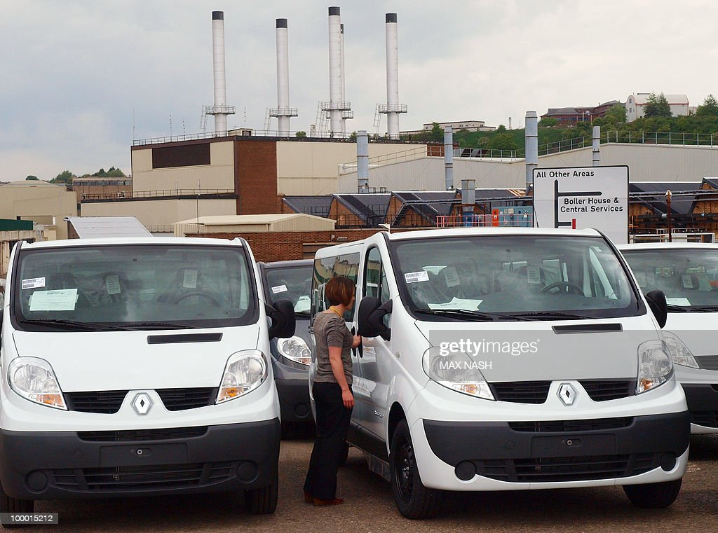 A Vauxhall worker in Luton, North of London, checks the new vans built at the factory on May 20, 2010 after the British government announced it had agreed a loan of 270 million pounds (298 million euros, 410 million dollars) for General Motors (GM) to help protect jobs in Britain. GM had decided to sell its European arm, which makes Vauxhall cars in Britain, but changed its mind after its own rescue by the US government. AFP PHOTO / Max NASH