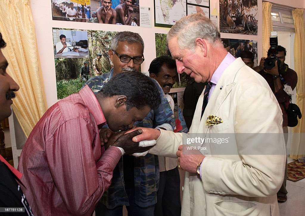 Vava Suresh, a snake-catcher whose hand has been bitten 266 times by snakes, kisses the hand of <a gi-track='captionPersonalityLinkClicked' href=/galleries/search?phrase=Prince+Charles+-+Prince+of+Wales&family=editorial&specificpeople=160180 ng-click='$event.stopPropagation()'>Prince Charles</a>, Prince of Wales (R) during his visit to the elephant corridor at Vazhachal Forest Range on November 12, 2013 near Chalakudy in the Thrissur district of Kerala, India. The Prince of Wales visited an area of the 2, 200 acre elephant corridor to view first-hand the success of elephant corridors in mitigating wildlife/human conflict and to highlight the work being done to prevent the illegal wildlife trade.