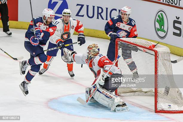 Vaxjo keeper Joacim Eriksson against Zurich forwards Patrick Thoresen and Pius Suter during the Champions Hockey League Quarter Final match between...