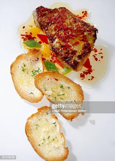 Veal steak with garlic bread