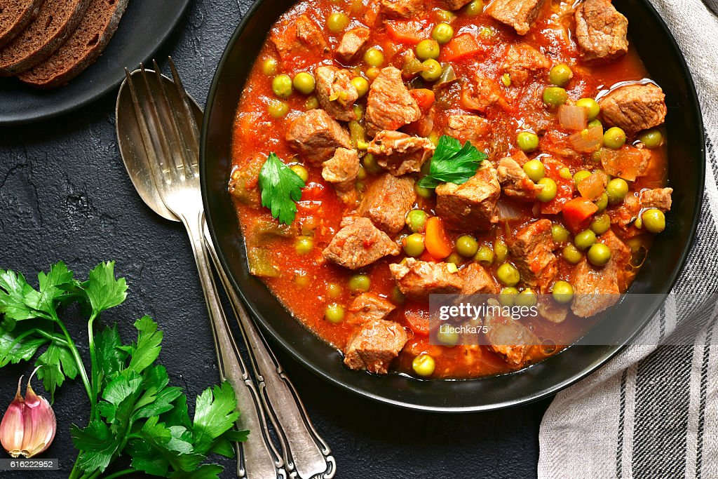 Veal stewed with vegetables in tomato sauce.Top view. : Stock Photo