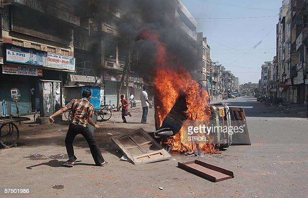 A vechile burns in the streets of the western city of Vadodara 01 May 2006 Two people were killed when mobs of Hindus and Muslims went on a rampage...
