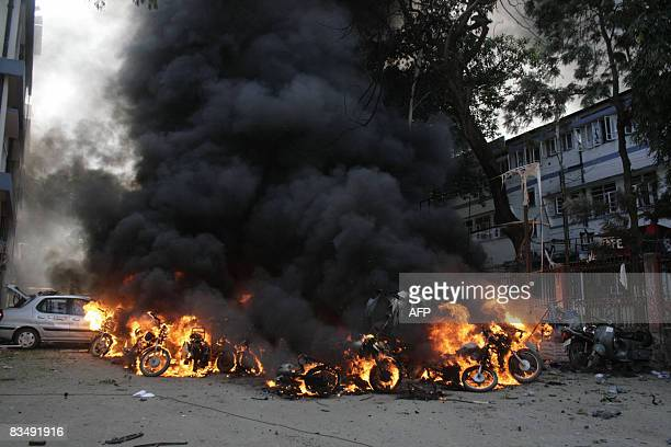 Vechiles blaze after powerful bombs exploded near the District Court in Guwahati the capital city of India�s northeastern state of Assam on October...