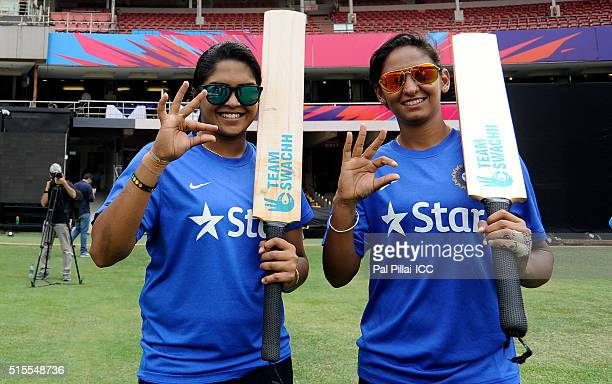 Veda Krishanmurthy and Harmanpreet Kaur of India poses for a photograph during an Women's ICC World Twenty20 India 2016 Team Swachh cricket clinic in...