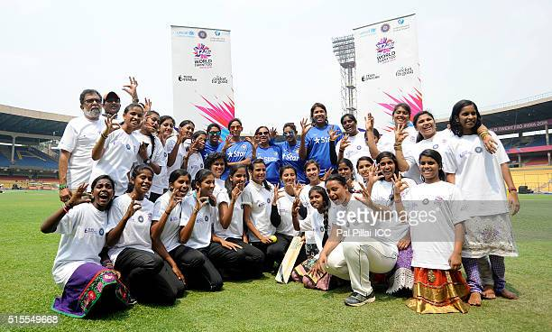 Veda Krishanmurthy Harmanpreet Kaur Mithali Raj and Jhulan Goswami of India pose for a photograph with the local kids during an Women's ICC World...