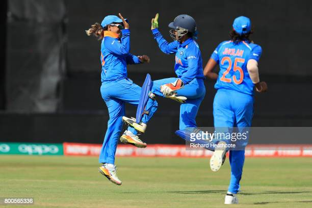 Veda Krishnamurthy and Sushma Verma of India celebrate taking the final wicket during the England v India group stage match at the ICC Women's World...
