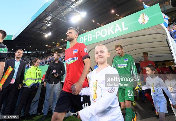 Vedad Ibisevic and Rune Almenning Jarstein of Hertha BSC enter the pitch during the game between FC Hansa Rostock and Hertha BSC on August 14 2017 in...