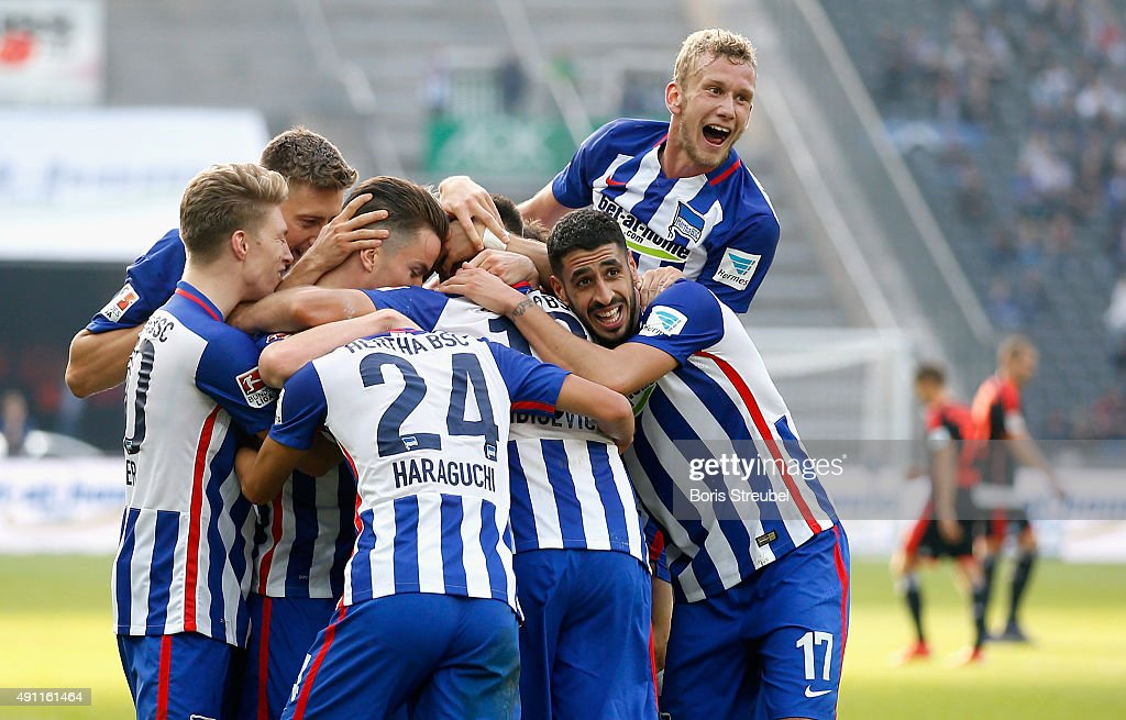 Vedad Ibisevic celebrates with his team mates after scoring his team's third goal during the Bundesliga match between Hertha BSC and Hamburger SV at Olympiastadion on October 3, 2015 in Berlin, Germany.