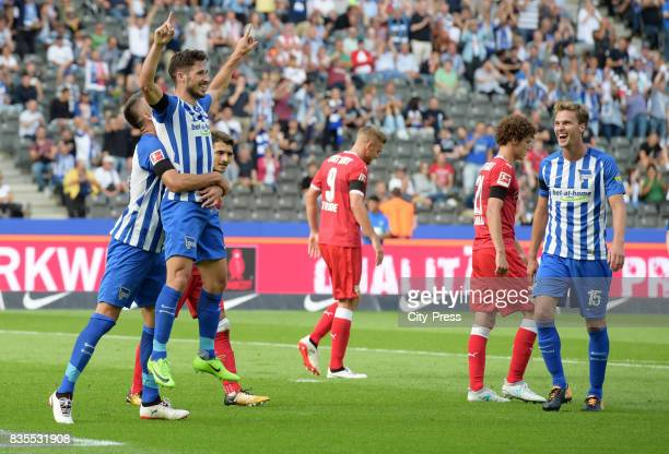 Vedad Ibisevic Mathew Leckie and Sebastian Langkamp of Hertha BSC celebrate after scoring the 20 during the game between Hertha BSC and dem VfB...